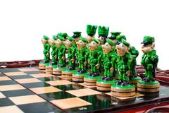 Chess in the form of military against prisoners on the board.  Stock Photos