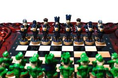 Chess in the form of military against prisoners on the board.  Royalty Free Stock Photography