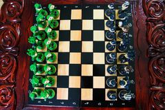 Chess in the form of military against prisoners on the board.  Royalty Free Stock Photos