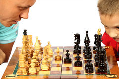 Chess-game. The daddy and the son play chess at leisure Stock Photography