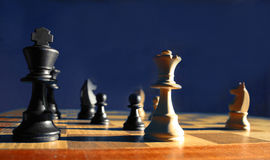 Chess Game. Dramatic side lit image of a chess game Royalty Free Stock Photo