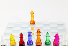 Chess game. Board of colorful Glass chess Royalty Free Stock Photo