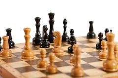 Chess game. Strategy and competition chess game figures on wood board royalty free stock photo