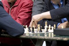 The chess game. Businessmen playing chess in a park Stock Images