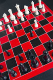 Chess Game Pieces Board Red White Black Background Royalty Free Stock Photography