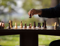Chess game. A hand moving chess figure in a chess game Royalty Free Stock Photo