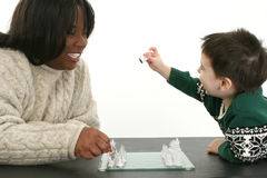 Chess Game. Beautiful African American Woman and two year old boy playing chess together Royalty Free Stock Photography