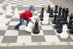 Chess game. Little girl and chess game stock images