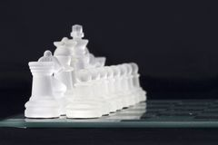 Chess game. Glass chess-men in action Stock Photo