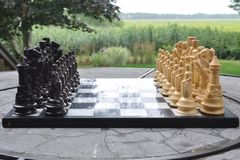 Chess game. Battle chess pieces pawn king queen castle stock photo