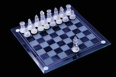 Chess game board. A crystal chess game board with one piece against many Stock Image