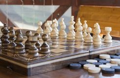 Chess and checkers Royalty Free Stock Photos
