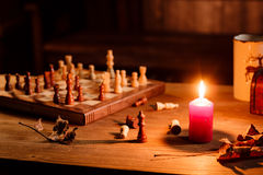 Chess game with the candle Royalty Free Stock Photography