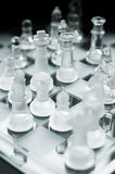 Chess game. Close up of a transparent chess board with focusing on the king Royalty Free Stock Images