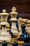 Chess game, close up of a white king, other figures in the front Stock Photography