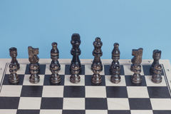 Chess game concept with chess pawns and wooden chess board. Royalty Free Stock Images