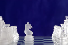 Chess game figures on blue background Royalty Free Stock Photography