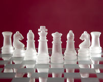 Chess game figures on red background Royalty Free Stock Photography