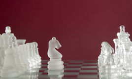 Chess game figures on red background Royalty Free Stock Photo