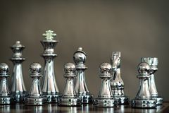 Chess game. A group of silver chess team. Business strategy and team work concept. Focus on pawns at front row. Copy space achievement adrenaline ahead stock photography