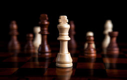 Chess game with the king in the center Stock Images