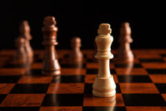 Chess game with the king in the center Stock Photos