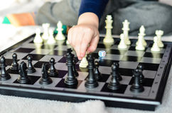 Chess game. Little  child playing  chess game at home Royalty Free Stock Photo