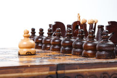 Chess game with lonely white pawn in front of enemies. Wooden Chess Game with lonely and courageous pawn in front of enemies, white background, isolated royalty free stock photos