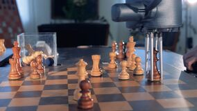 Chess game between man and robot. 4K stock footage