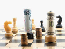 Chess game with money stock image