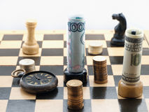 Chess game with money Stock Images