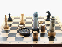 Chess game with money Royalty Free Stock Photography
