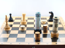 Chess game with money stock photos