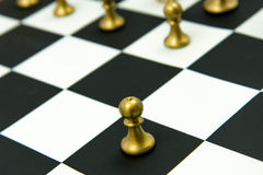 Chess game - pawn alone in front on chessboard Royalty Free Stock Photography