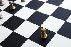 Chess game - pawn alone in front on chessboard Stock Photos