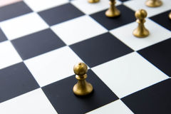 Chess game - pawn alone in front on chessboard Royalty Free Stock Image