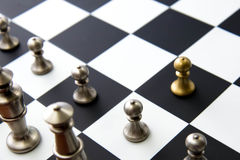 Chess game - pawn alone in front on chessboard Royalty Free Stock Photos