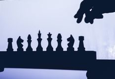 Chess game, chess piece on the floor, chess silhouettes.  stock image