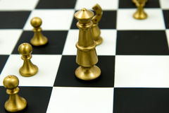Chess game - pieces in play on chessboard Royalty Free Stock Image