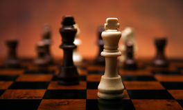 Chess game with pieces on the table. Close up Stock Photography