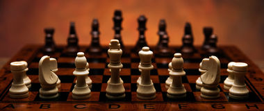 Chess game with pieces on the table. Close up Stock Image