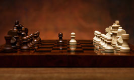 Chess game with pieces on the table Stock Image