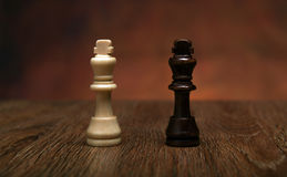 Chess game with pieces on the table Stock Photos
