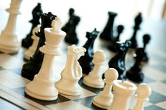 Chess Game. A game of chess in play with black and ivory pieces Stock Photos