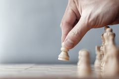 Chess game player makes a move the white pawn one step forward. royalty free stock photos
