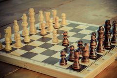 Chess game set with wooden chess pieces. Royalty Free Stock Photography
