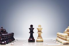 Chess game two kings in centre of board other pieces lined up stock photography