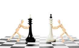 Chess game. Two men move kings on a chessboard Royalty Free Stock Image