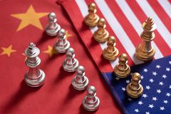 Chess game. Two team stand confront each other on China and USA national flags. Trade war concept. Copy space, against, battle, business, cash, challenge royalty free stock photography