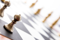 Chess game - view of playing pieces on chessboard Stock Images